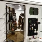 Interior shot of a loaded tack room and saddle racks