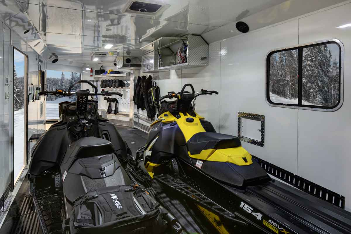 2 snowmobiles inside an RPM Trailer